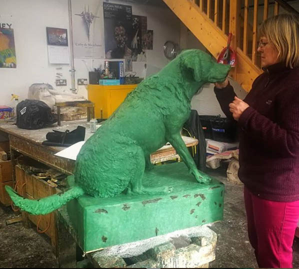 Artist Judy Boyt working on the wax of one of her life size Labradors at Talos today