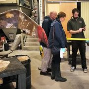 Talos team member Pat talking to visitors about a recent restoration project after a patination demonstration