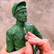 William Newton working on wax maquette of Lester Piggott