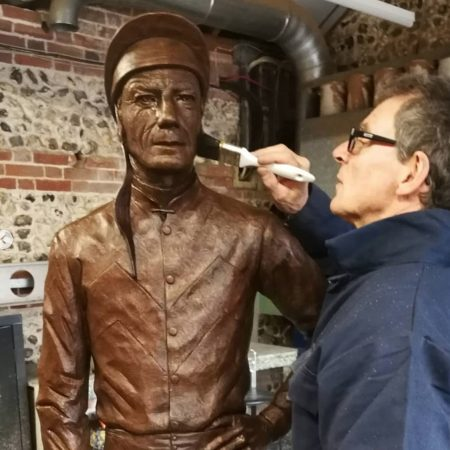 Wax being applied to Lester by artist William Newton